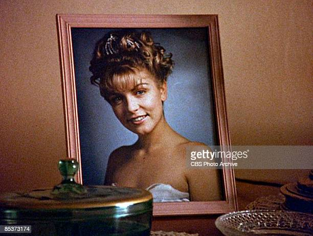 Closeup of a framed photograph of the character Laura Palmer as it sits on a table in a scene from the pilot episode of the television series 'Twin...