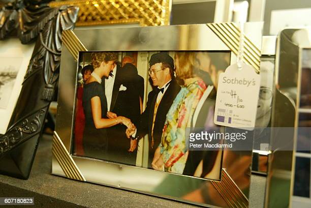 Closeup of a framed photograph tagged by Sotheby's for an auction in John's home London England September 12 2003