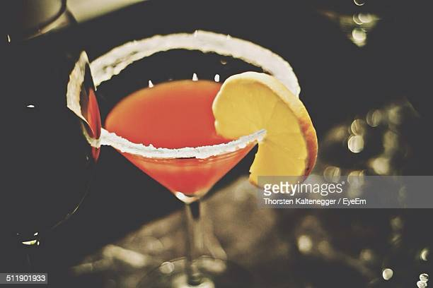 Close-up of a garnished drink against blurred background