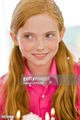 Close-up of a girl celebrating her birthday : Stock Photo