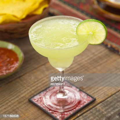 Close-up of a glass of margarita on a red coaster