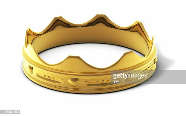 Close-up of a golden ring in crown shape