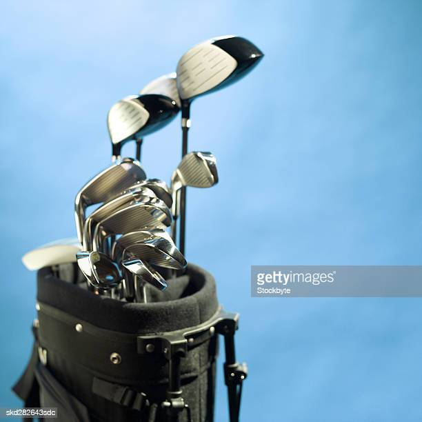 Close-up of a golf bag containing golf clubs
