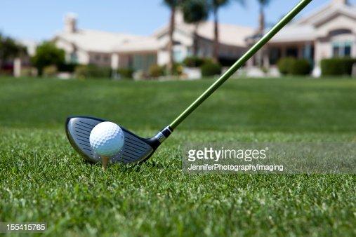 Close-up of a golf ball about to be hit in a field
