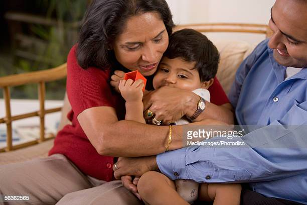 Close-up of a grandmother sitting with her son and her grandson