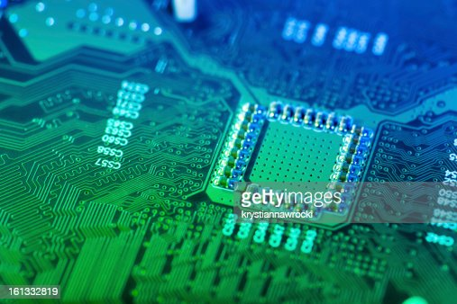 A closeup of a green and blue computer circuit board