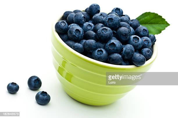 Close-up of a green bowl filled with blueberries