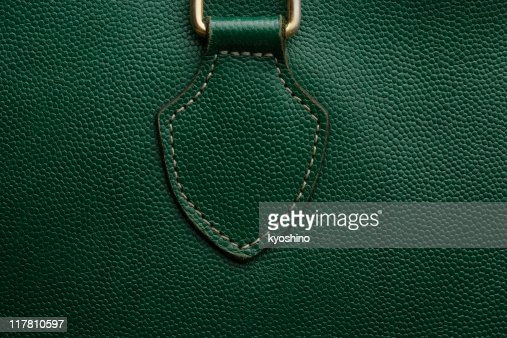 Close-up of a green leather bag texture background