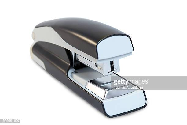 Closeup of a grey office stapler isolated on white