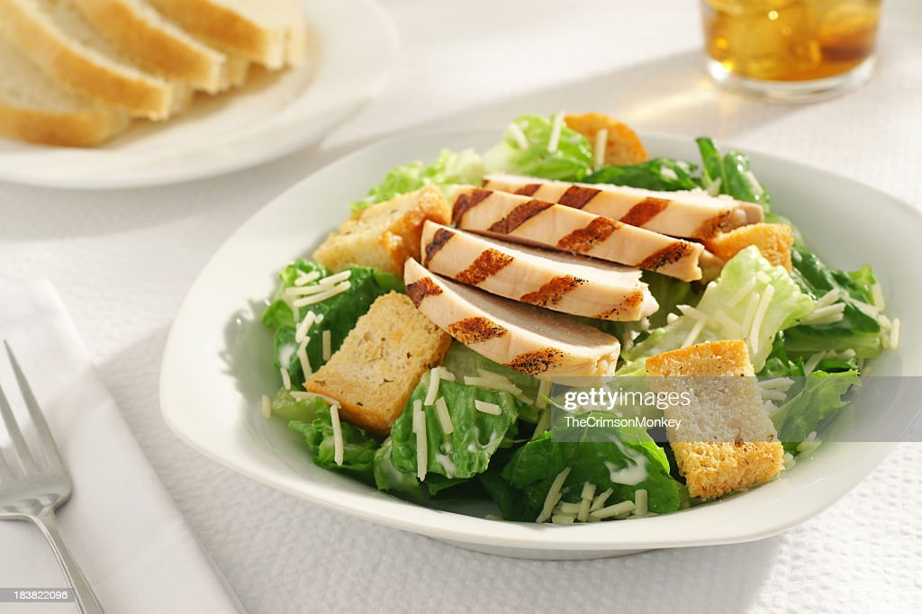 A close-up of a grilled chicken Caesar salad for lunch : Stock Photo