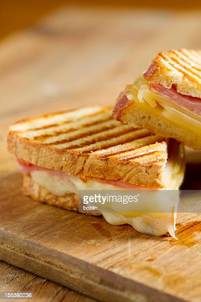 A closeup of a ham and cheese panini sandwich