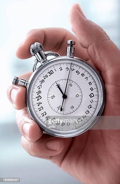 Main avec chronomètre classique