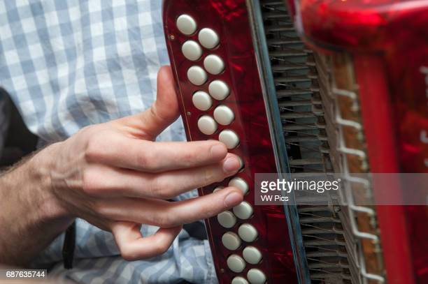 Closeup of a hand pushing accordion buttons in Baltimore MD