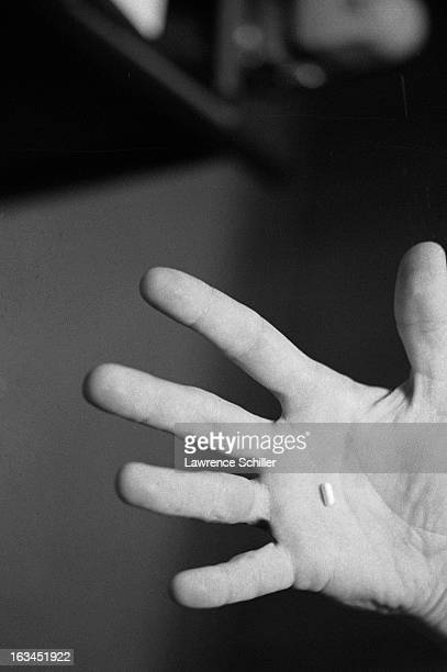 Closeup of a hand that holds a LSD capsule California 1966