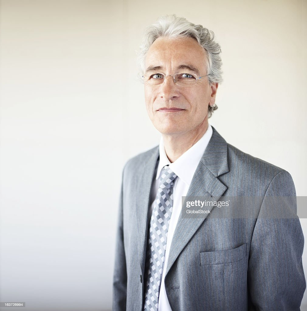 Close-up of a happy senior businessman : Stock Photo