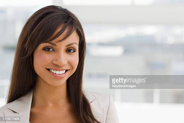 Closeup of a happy young business woman