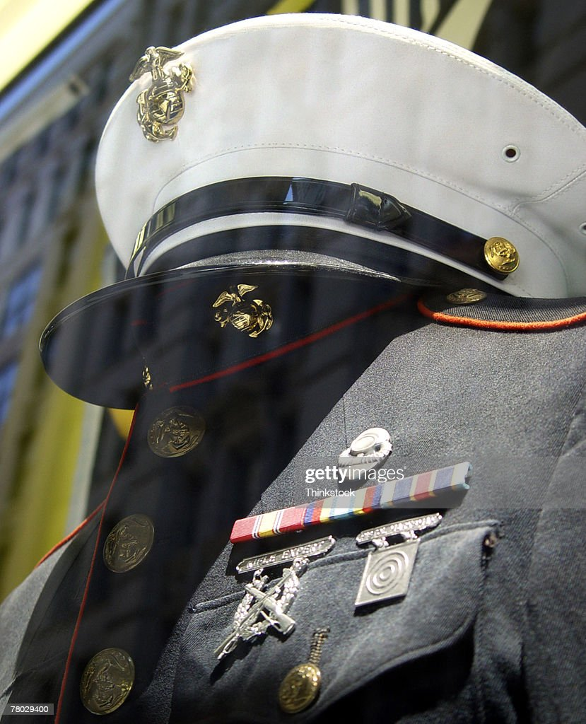 Close-up of a hat and uniform for the USMC in a store window display.