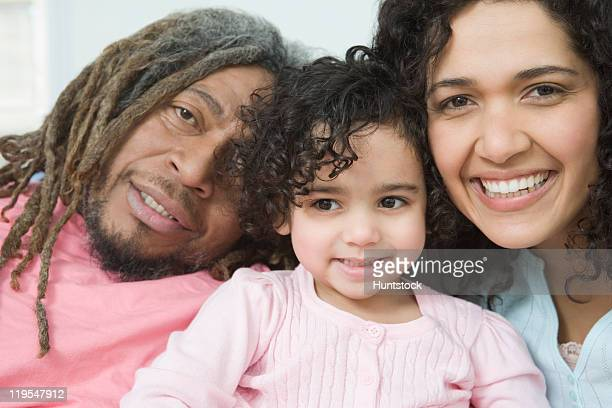 Close-up of a Hispanic girl smiling with her parents