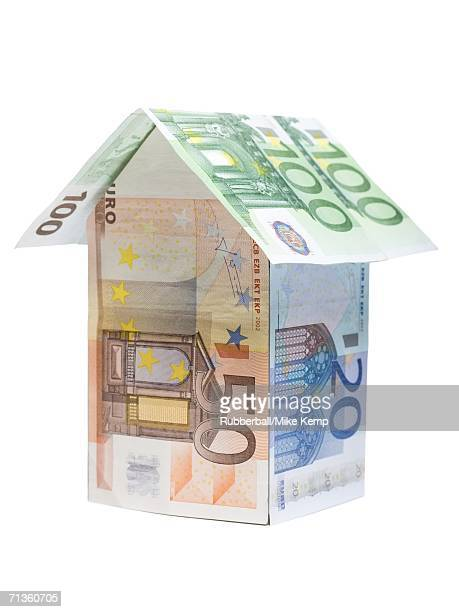 Close-up of a house made of Euro notes