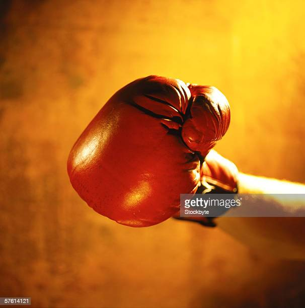 Close-up of a human hand wearing a boxing glove