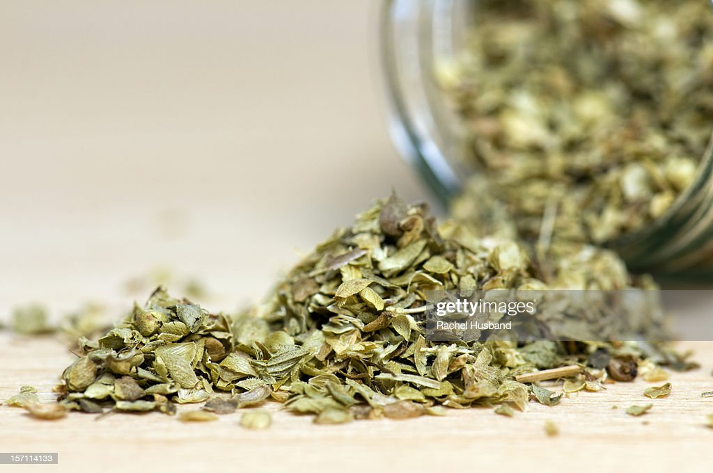 Close-up of a jar of dried oregano : Stock Photo