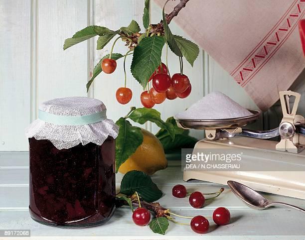 Closeup of a jar of sour cherry jam