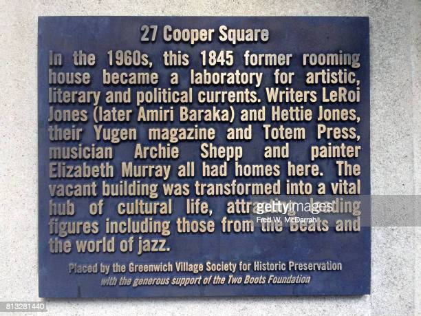 Closeup of a justunveiled historic plaque outside an apartment building at 27 Cooper Square New York New York June 20 2017 The plaque commemorated...