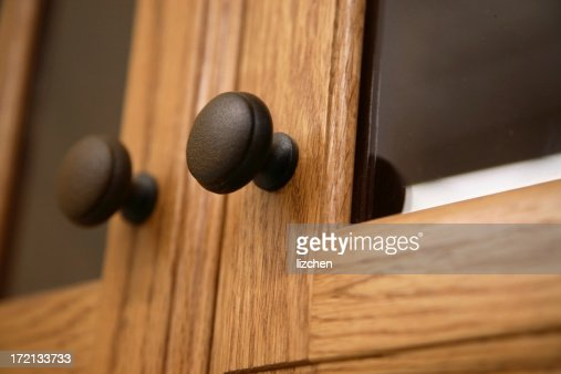 Close-up of a kitchen cabinet door knob in wood