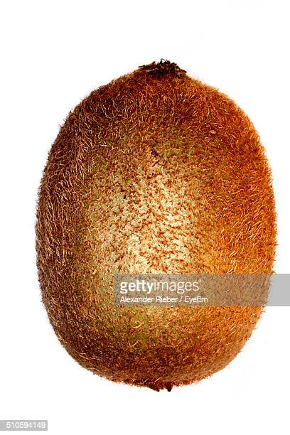 Close-up of a kiwi over white background