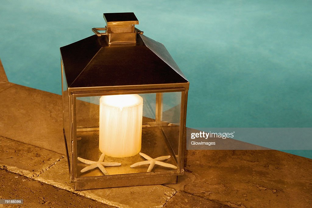 Close-up of a lantern at the poolside : Foto de stock
