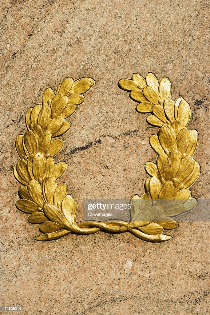 Close-up of a laurel wreath on a wall