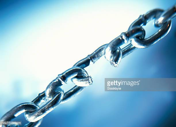 close-up of a link broken on a chain link