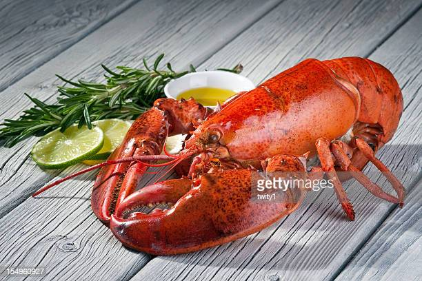 Close-up of a lobster on a wood table