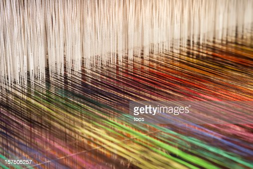 Close-up of a loom weaving colorful fabric (XXXL)