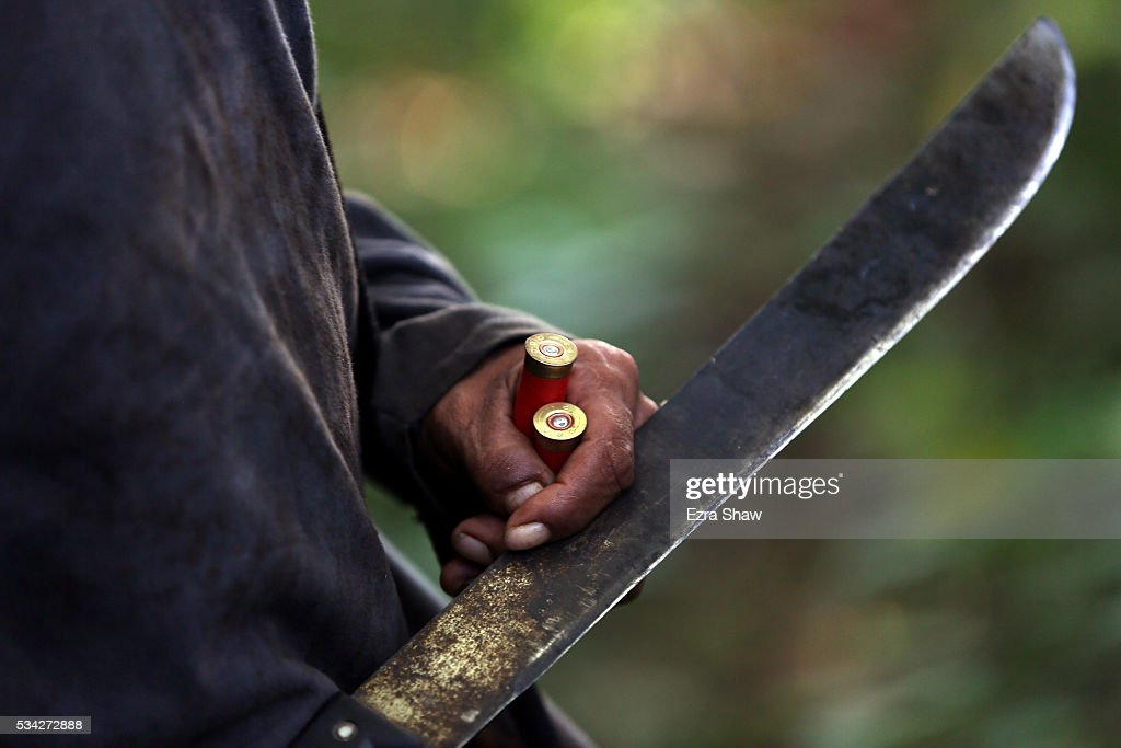 A closeup of a machete Ecutia walks through a field during a hunt on May 7 in Kamayura Brazil Although the Kamayura tribe eats very little meat they...
