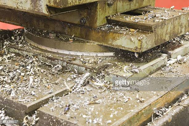 Close-up of a machine with metal shavings