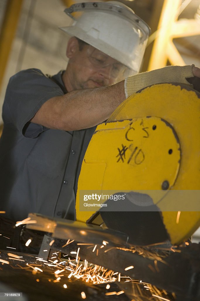 Close-up of a male construction worker working at a construction site : Foto de stock