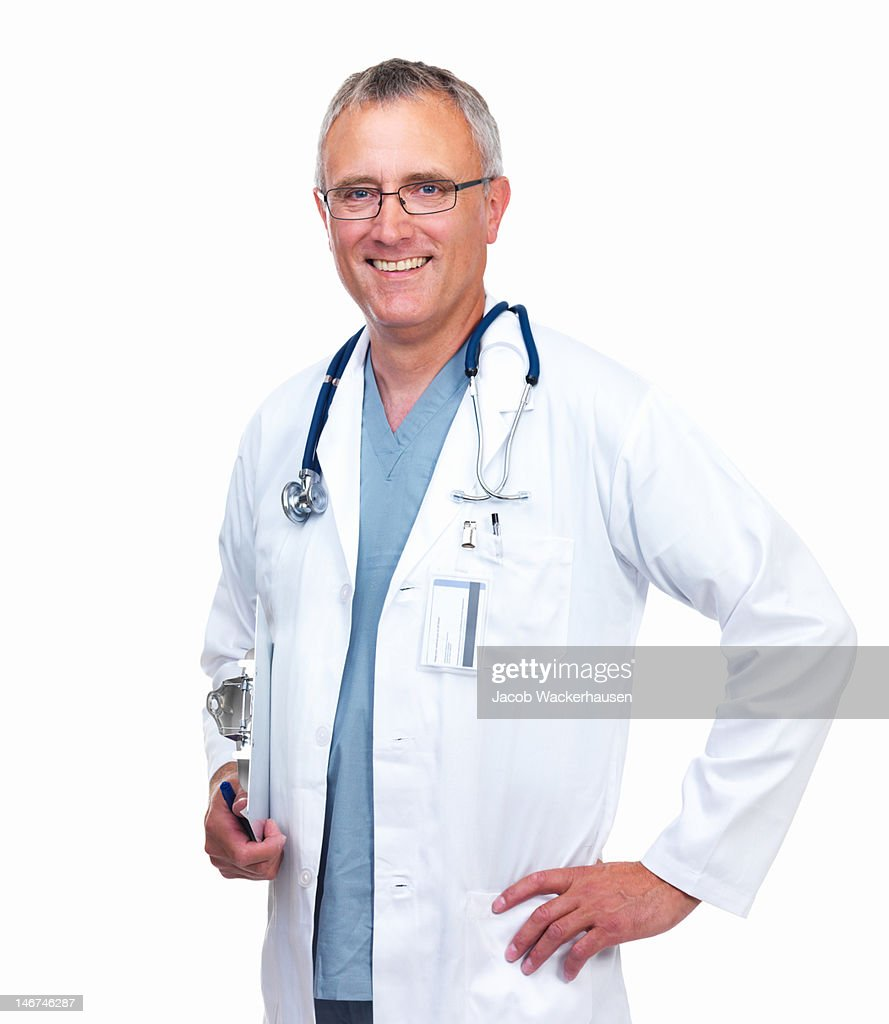 Close-up of a male doctor smiling on white background : Stock Photo