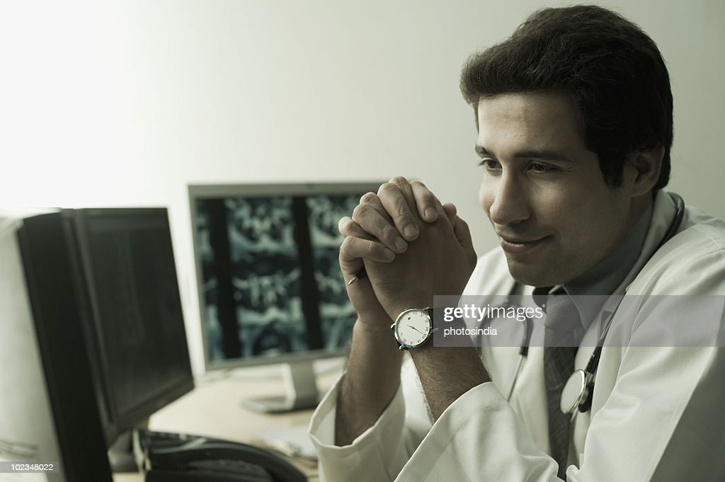 Close-up of a male doctor smiling : Stock Photo