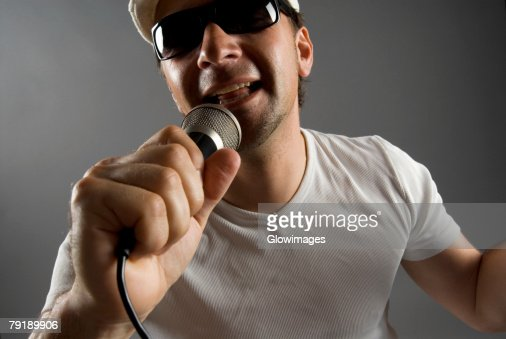 Close-up of a male singer singing : Stock Photo