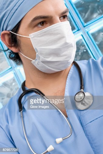 Close-up of a male surgeon wearing a surgical mask : Stock Photo