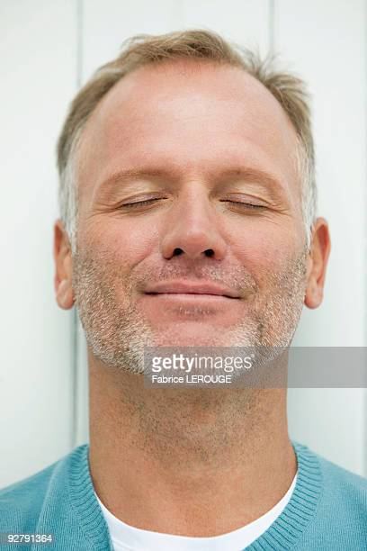 Close-up of a man day dreaming