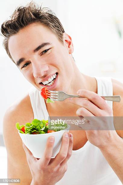 Close-up of a man eating healthy food