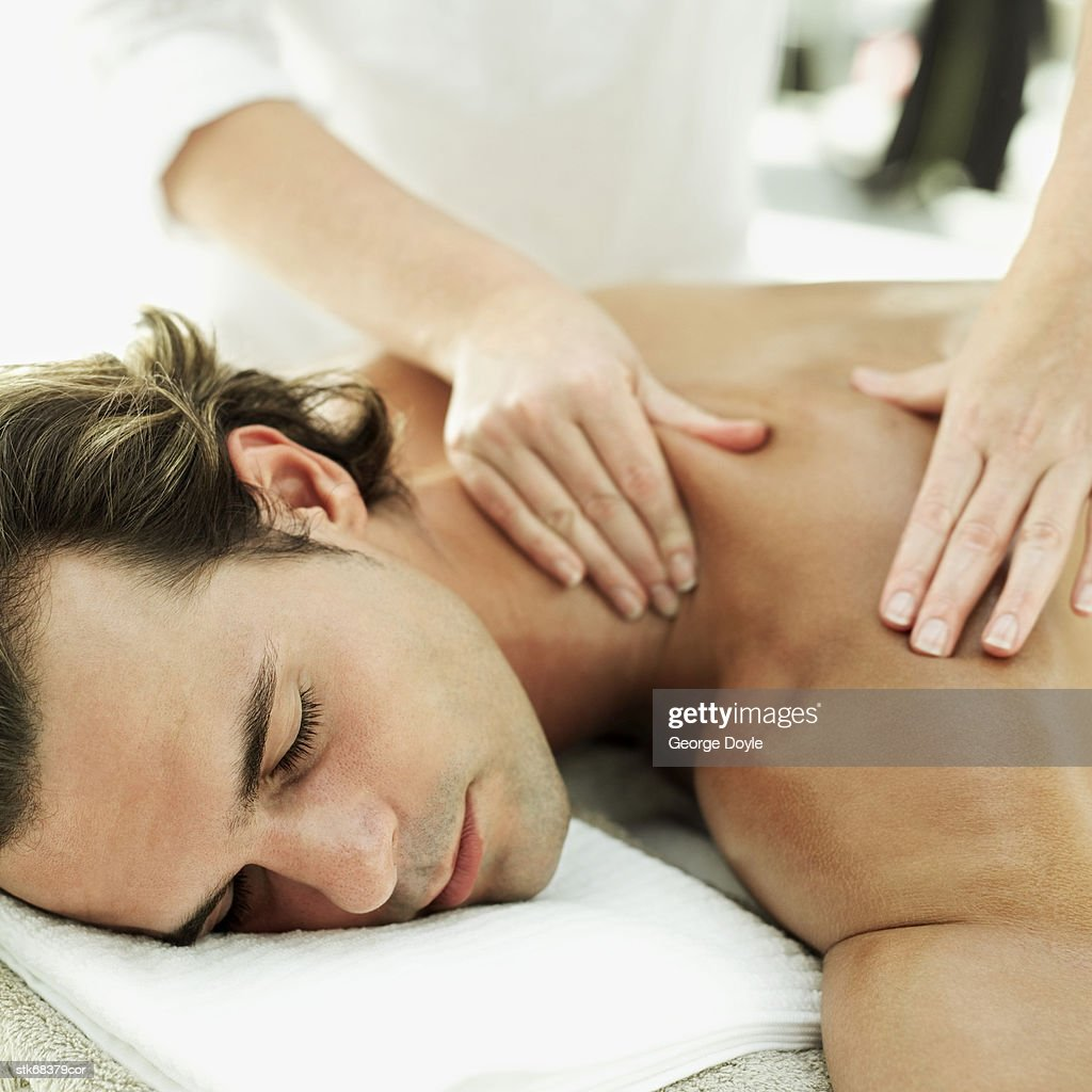 close-up of a man getting his back massaged from a masseuse : Stock Photo
