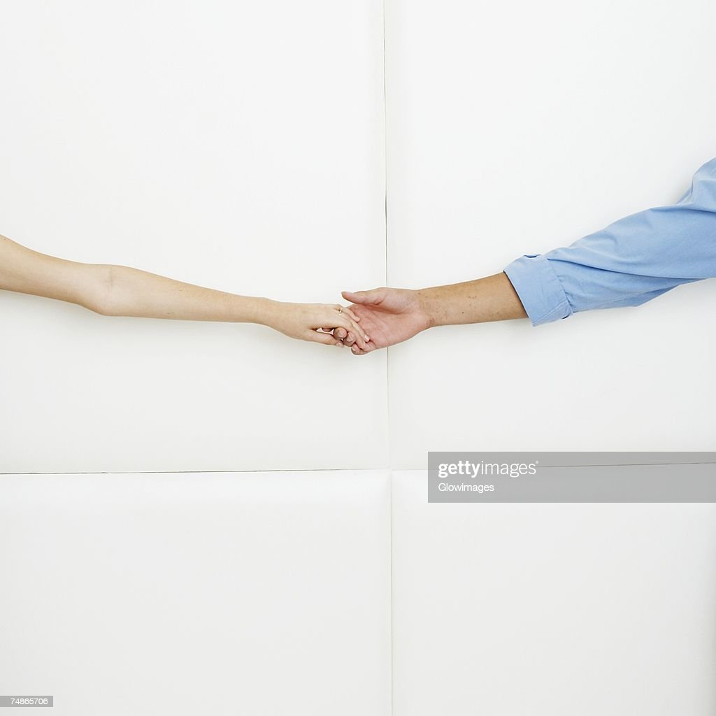 Close-up of a man holding a woman's hand