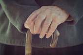 Close-up of a Man holding walking stick