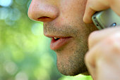 Close-up of a man talking on a mobile phone