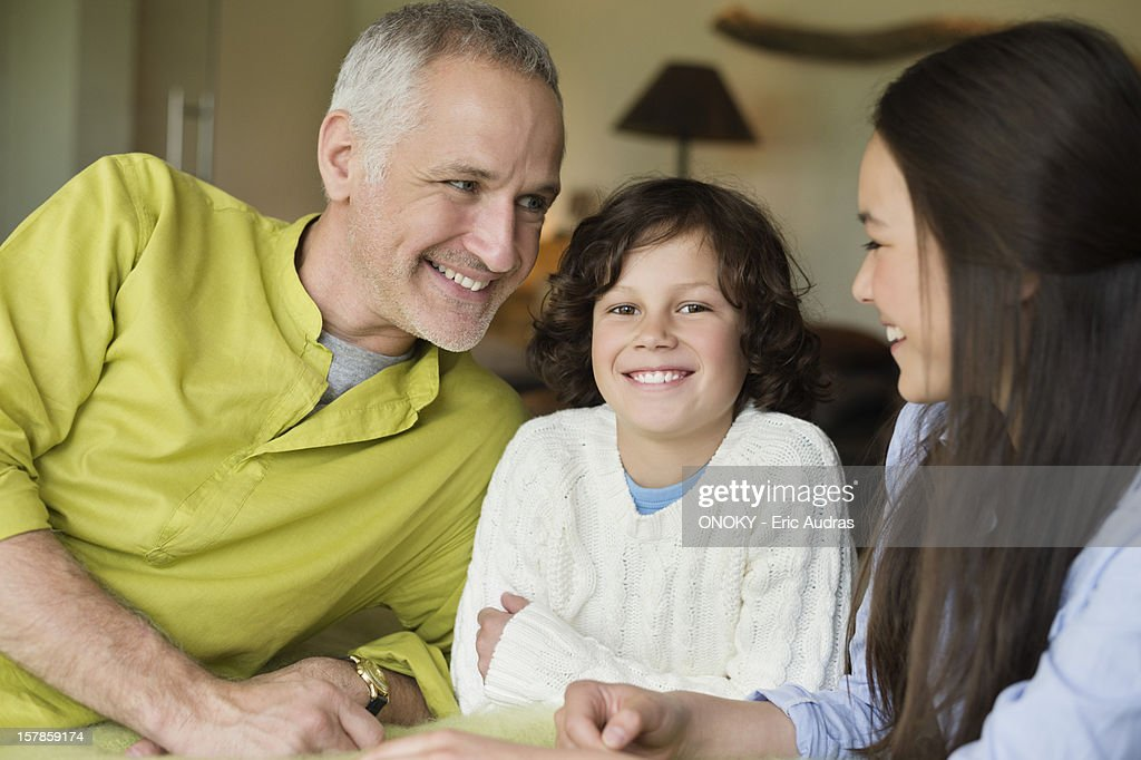 Close-up of a man with his children smiling : Stock Photo