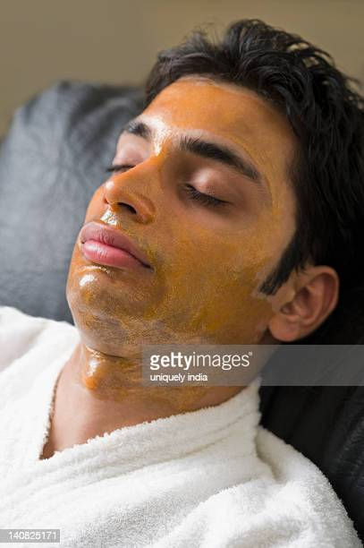 Close-up of a man with peel off mask