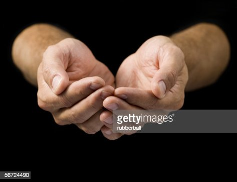 closeup of a mans cupped hands stock photo getty images